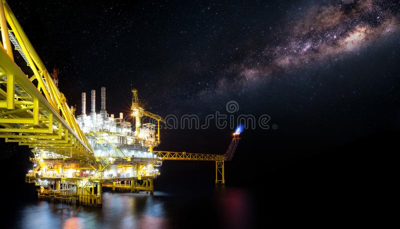Offshore oil and gas platforms are in the process of releasing gas to the flame platform to reduce the pressure in the production stock photo