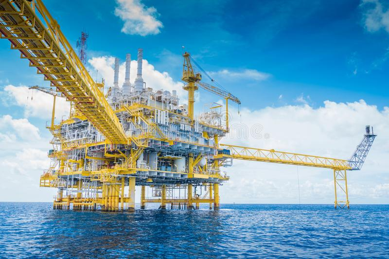 Offshore oil and gas industry produced raw gas and crude then sent to onshore refinery. Offshore oil and Gas processing platform, oil and gas industry to treat stock photos