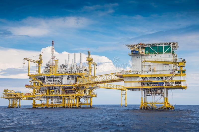 Offshore oil and gas processing platform produced gas and crude oil condensate and sent to onshore refinery. World energy and petrochemical, Oil and gas stock photo