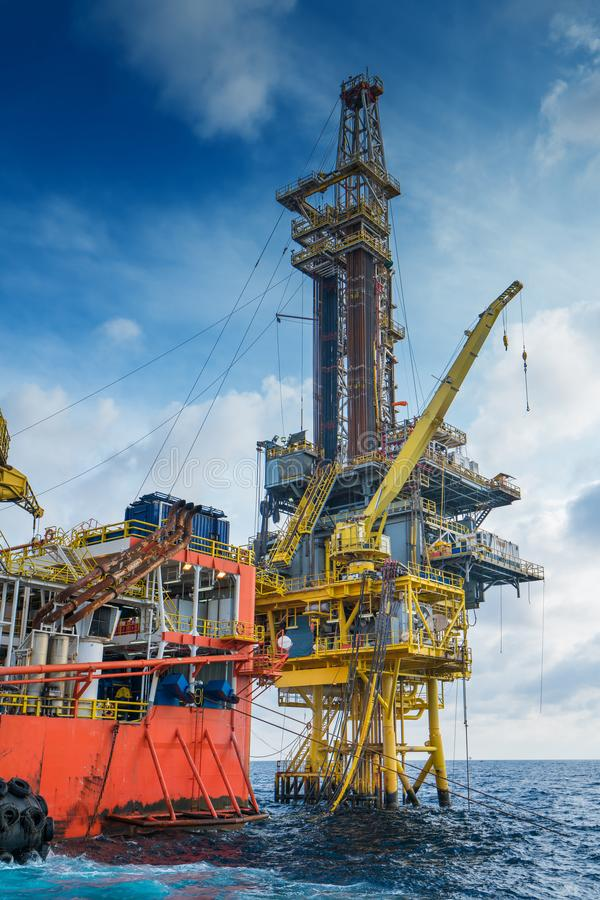 Offshore oil and gas production and exploration, tender rig work over remote platform. Offshore oil and gas production and exploration, tender rig work over stock image