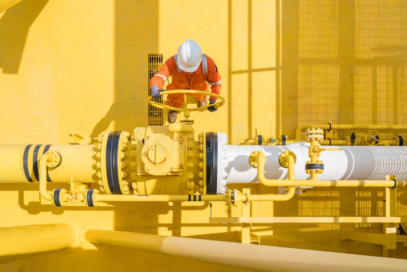 Offshore oil and gas site service operator open valve for control gases and crude product, Petroleum and chemical industry busines. S stock photography