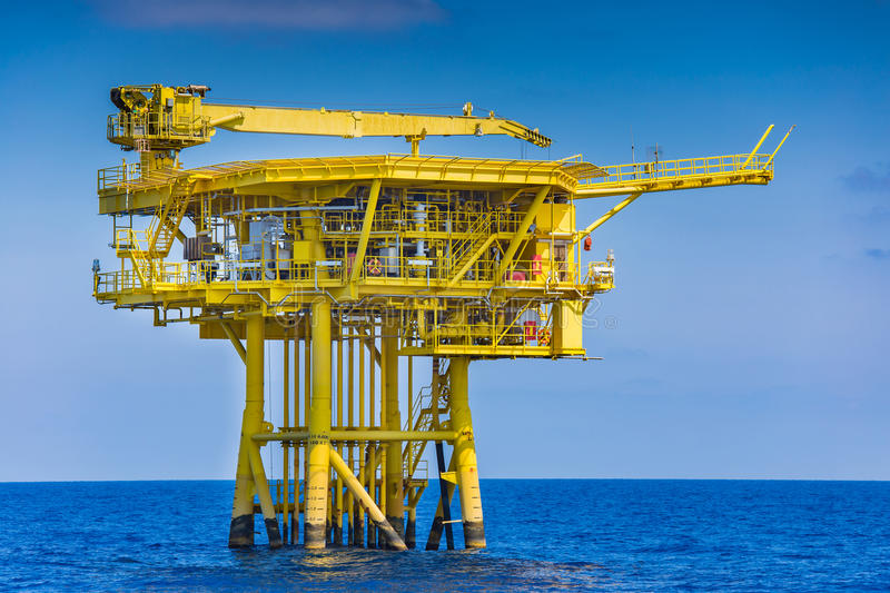 Offshore oil and gas wellhea remote platform produced raw gas and crude oil and sent to central processing platform stock images