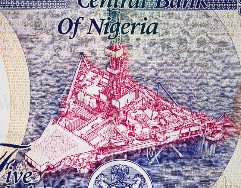 Offshore oil platform on Nigeria 500 naira 2016 banknote close royalty free stock photo
