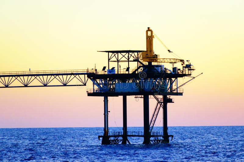 Offshore Oil Platforms. At sea in the Gulf of Mexico used in the oil and gas industry royalty free stock image