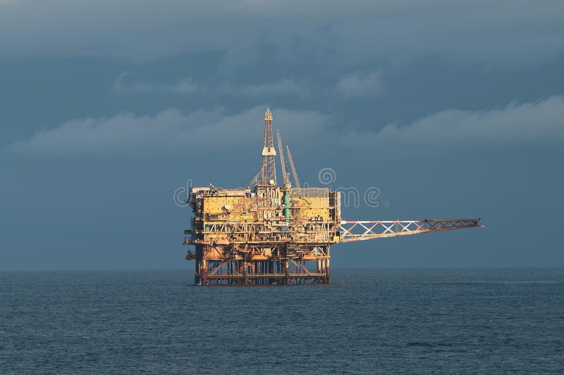 Offshore oil rig. Offshore fuxed oil rig (production platform) in cloudy day. Coast of Brazil, circa 2010 royalty free stock images