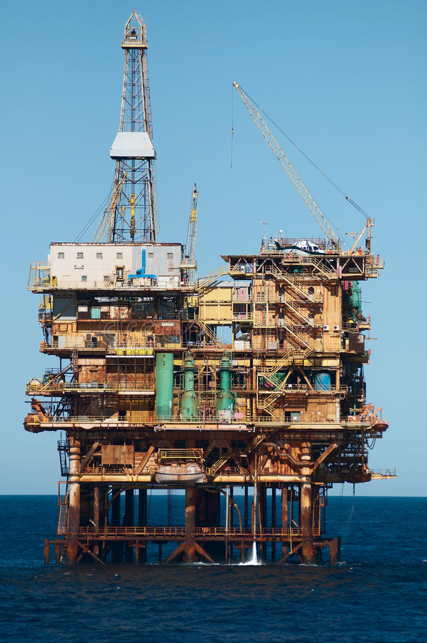 Offshore oil rig. Offshore fixed oil rig (production platform). Blue sky and calm seas. Coast of Brazil, circa 2010 royalty free stock photo