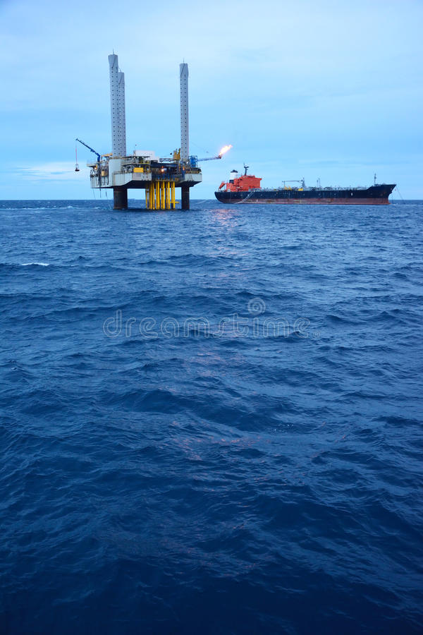 The offshore oil rig in early morning royalty free stock image