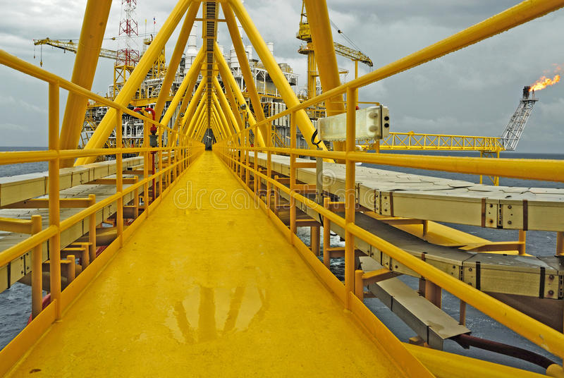 Offshore oil rig. Flare boom nozzle and fire on offshore oil rig royalty free stock photography