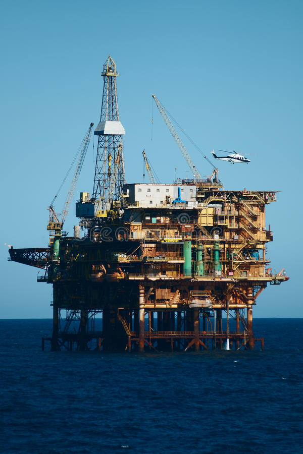Offshore oil rig with helicopter royalty free stock photography