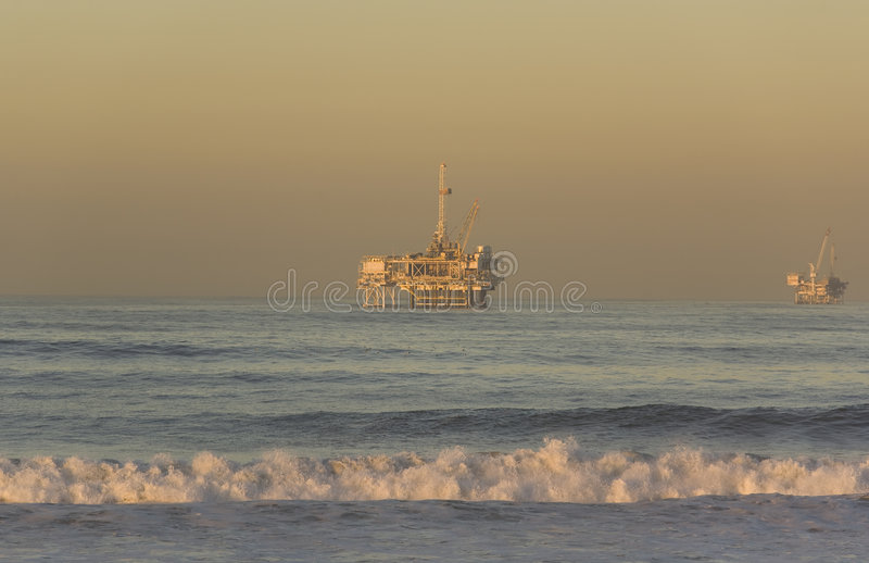 Offshore Oil Rigs Huntington Beach California. Offshore Oil Rigs taken from Huntington Beach California at Dawn royalty free stock photography