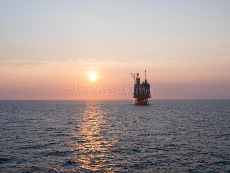 Download Offshore platform sunrise stock photo. Image of production - 32205270