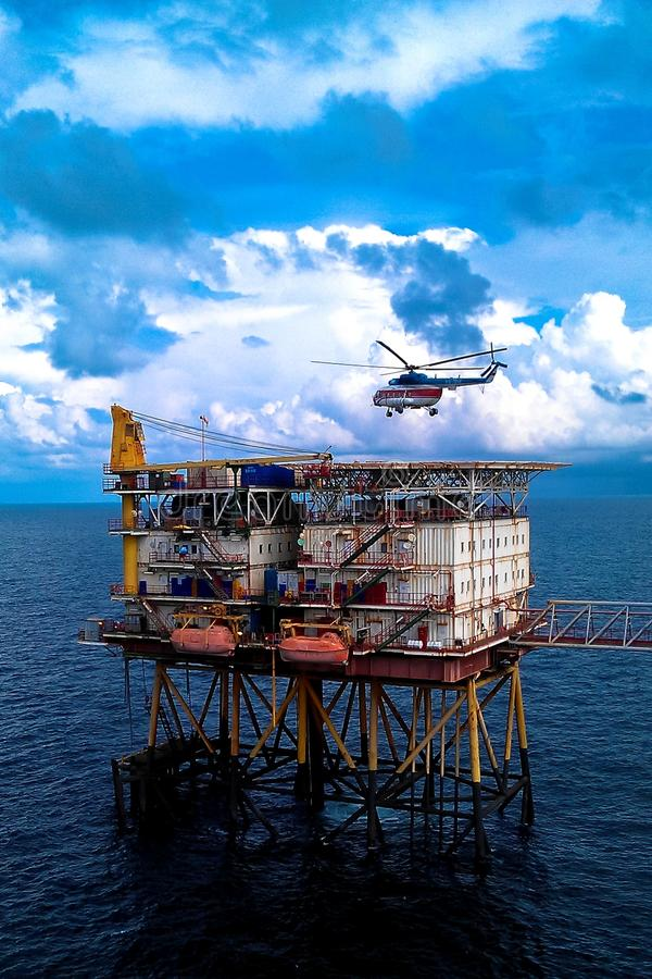 Offshore production platform with hlicopter stock photos