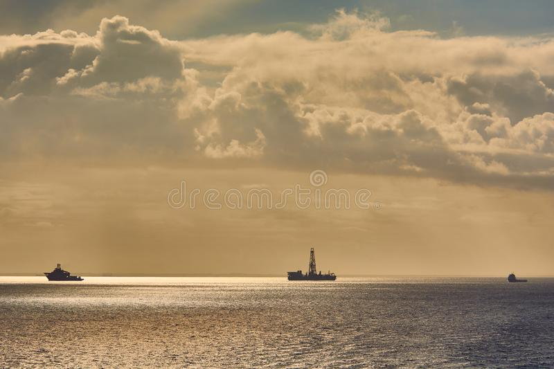 Offshore supply and diving support vessel working on a oil industry project at sea. Offshore supply and diving support vessel working on a oil industry project stock photo