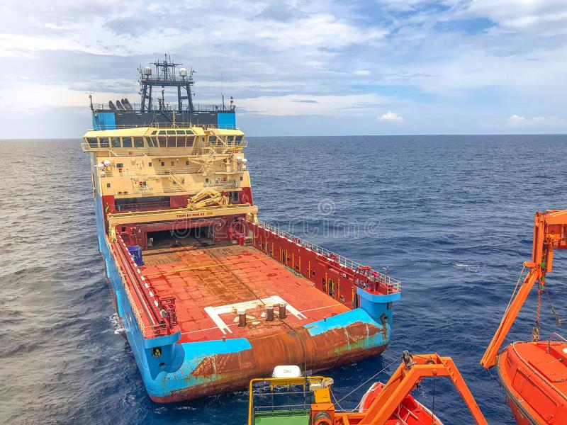 Offshore supply tug vessel close engaged in towing operations stock photo