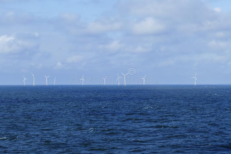 Offshore wind farm, wind turbines for power generation, in the North Sea royalty free stock images