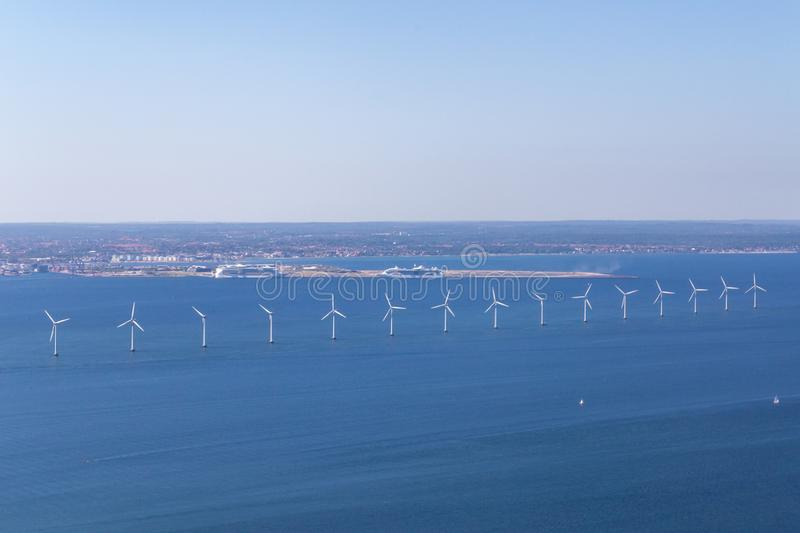 Offshore Wind Power Plants in Copenhagen, Denmark. Copenhagen, Denmark - June 06, 2018: Aerial view of offshore wind power plants royalty free stock image