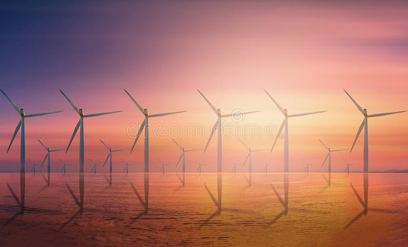 Offshore Wind Turbine in a Wind farm under construction off coast at sunset. royalty free stock photos