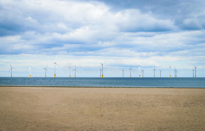 Offshore Wind Turbine in a Wind farm under construction stock photography