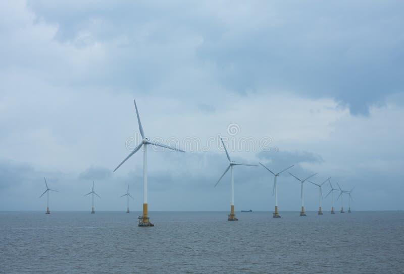 Offshore wind turbines arrays stock photos