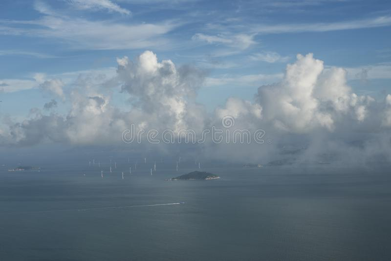 Offshore wind turbines in Hong Kong seen from a plane. stock photos