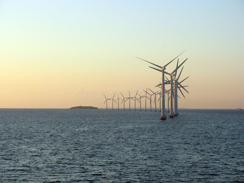 Offshore windfarm 1. Offshore windfarm near Copenhagen, Denmark on a sunset royalty free stock photo