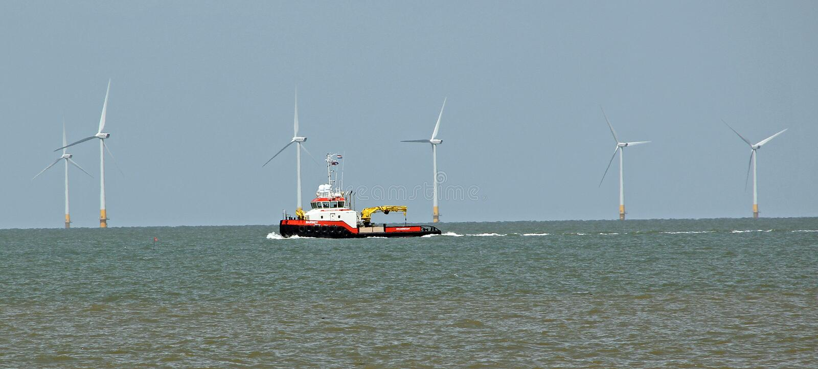 Offshore windfarm repairs. Photo of offshore windfarm repairs on the coast of whitstable in kent. photo taken 18th june 2015 and ideal for green energy,offshore royalty free stock image