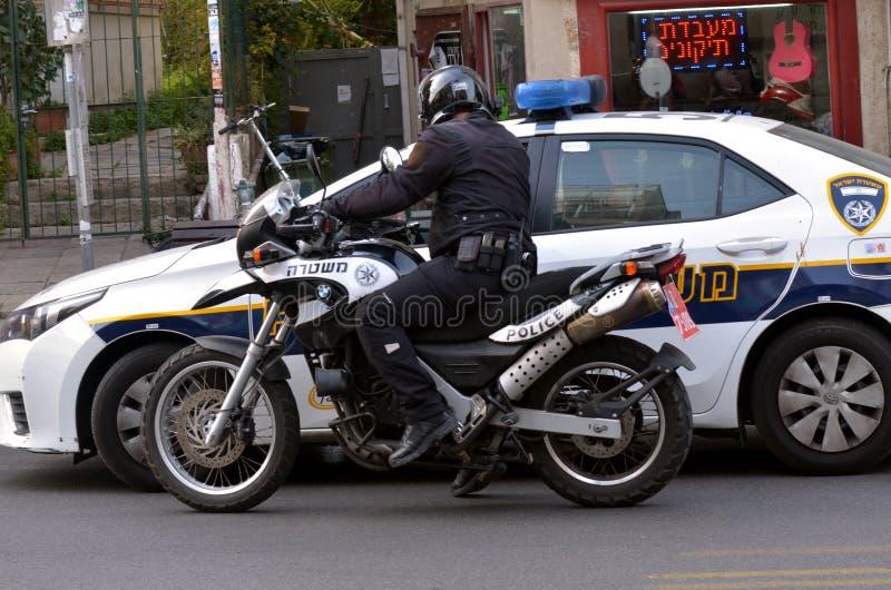 Oficial de Israel Police en una moto fotos de archivo libres de regalías