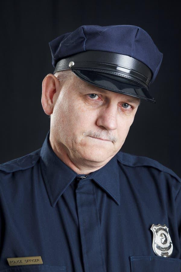Oficial de polícia nos rasgos imagens de stock royalty free