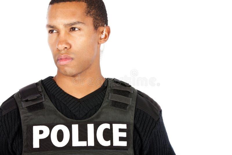Oficial de policía aislado en el fondo blanco fotografía de archivo libre de regalías