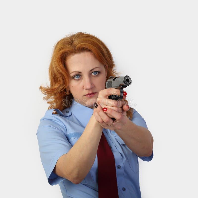Oficial de policía de la mujer en gris foto de archivo