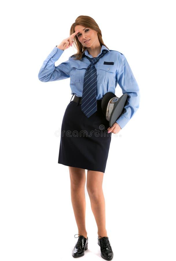 Oficial de policía de la señora en un backgro blanco fotografía de archivo
