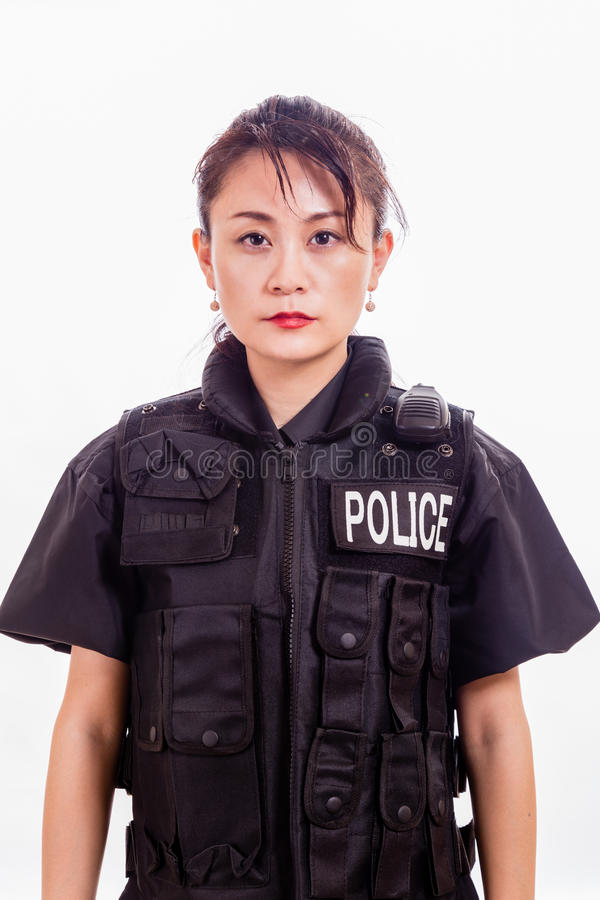 Oficial de policía de sexo femenino chino imagenes de archivo
