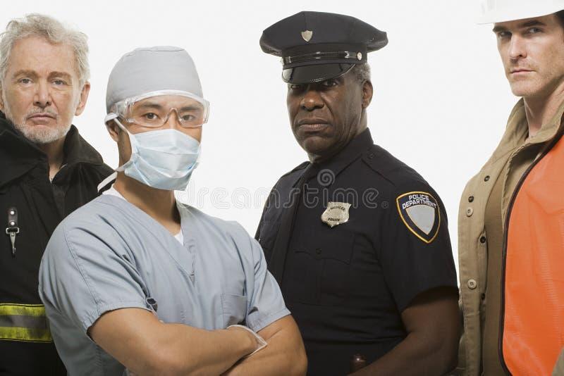 Oficial de policía del cirujano del bombero y trabajador de construcción foto de archivo libre de regalías