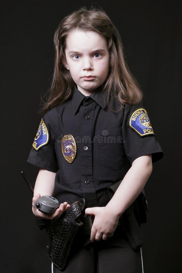 Oficial de policía del niño fotos de archivo