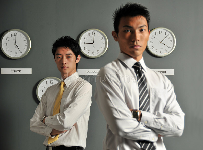 Oficina de negocios con los relojes 3 fotos de archivo