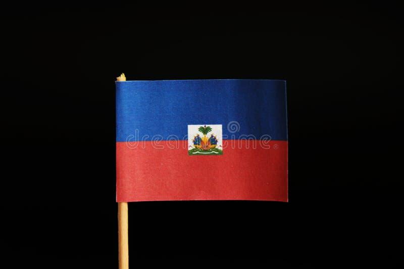 Oficjalna flaga Haiti na wykałaczce na czarnym tle Haiti cierpienie na wiele trzęsieniach ziemi Stan lokalizuje w centrali jest fotografia stock