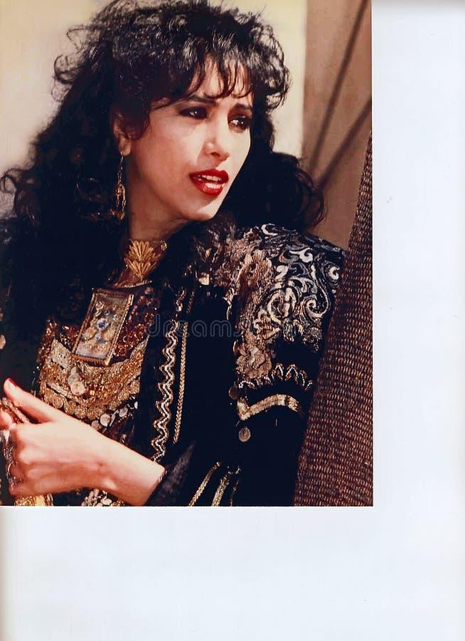 Ofra Haza. Israeli mega-star singer/recording artist, Ofra Haza, posing in traditional Yemenite attire, with a scenic backdrop of Jerusalem, was her country`s stock image