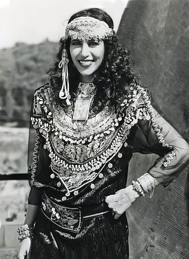Ofra Haza. Israeli mega-star singer/recording artist, Ofra Haza, posing in traditional Yemenite attire, with a scenic backdrop of Jerusalem, was her country`s stock photos