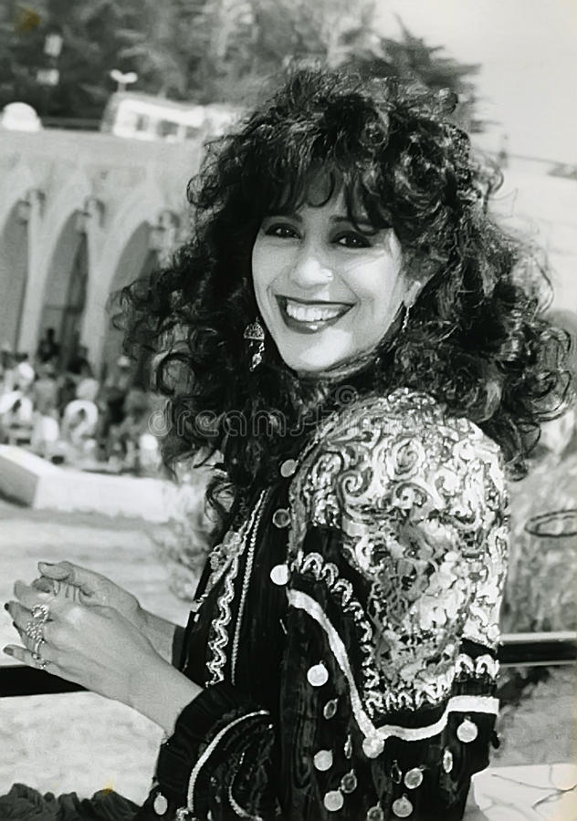 Ofra Haza. Israeli mega-star singer/recording artist, Ofra Haza, posing in traditional Yemenite attire, with a scenic backdrop of Jerusalem, was her country`s stock images