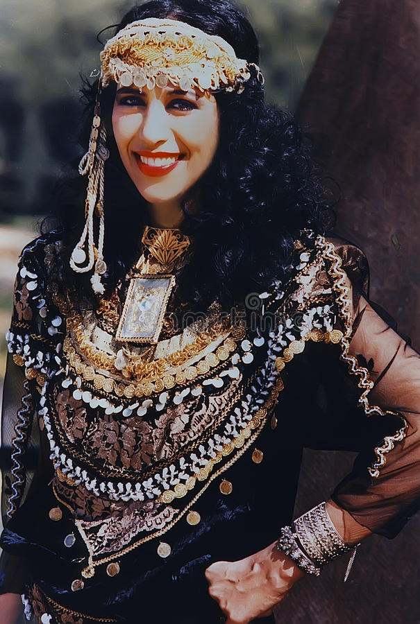 Ofra Haza. Israeli mega-star singer/recording artist, Ofra Haza, posing in traditional Yemenite attire, with a scenic backdrop of Jerusalem, was her country`s royalty free stock photos