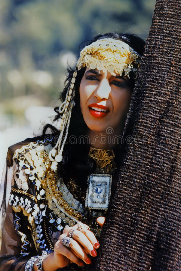 Ofra Haza. Israeli mega-star singer/recording artist, Ofra Haza, posing in traditional Yemenite attire, with a scenic backdrop of Jerusalem, was her country`s royalty free stock image