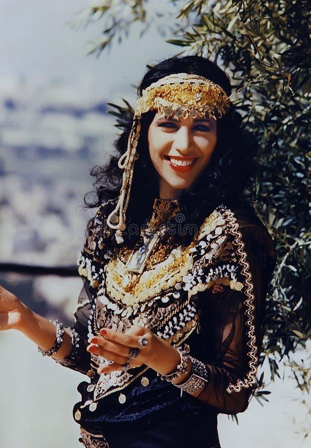 Ofra Haza. Israeli mega-star singer/recording artist, Ofra Haza, posing in traditional Yemenite attire, with a scenic backdrop of Jerusalem, was her country`s stock photo