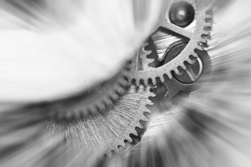 Черно-белая предпосылка Cogwheels металла в механизме часов Макрос стоковые изображения