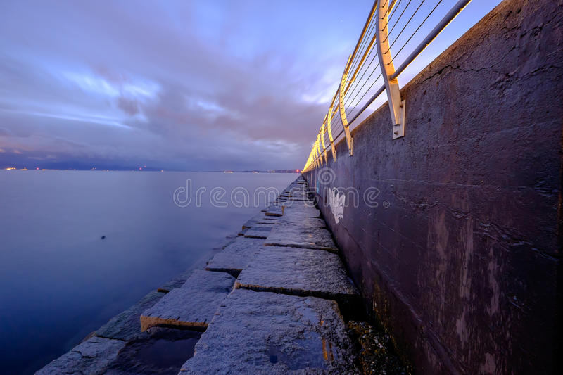 Ogden point breakwater, long exposure with grey clouds stock photo