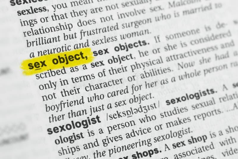 Oggetto sessuale inglese evidenziato di parola e la sua definizione al dizionario fotografia stock libera da diritti