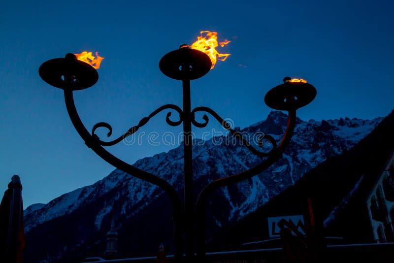 Ogień i płomień trzy pochodni palić fotografia stock