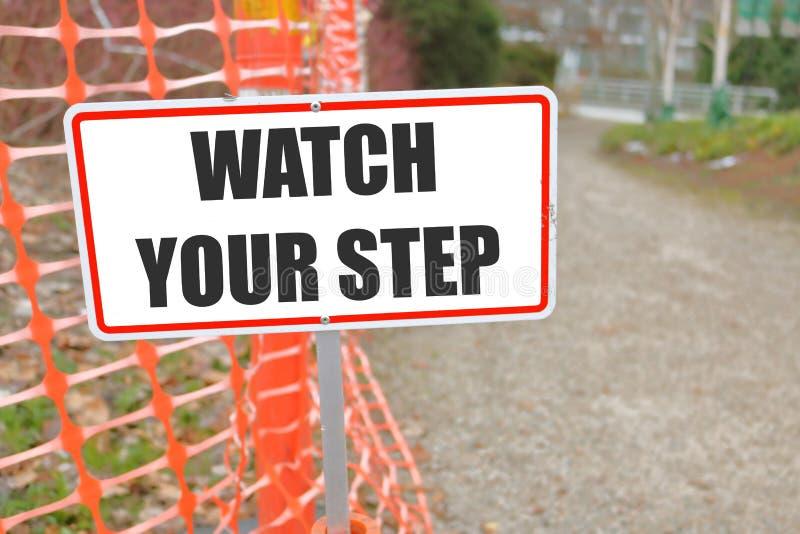 Ogląda Twój kroka Signage obrazy stock