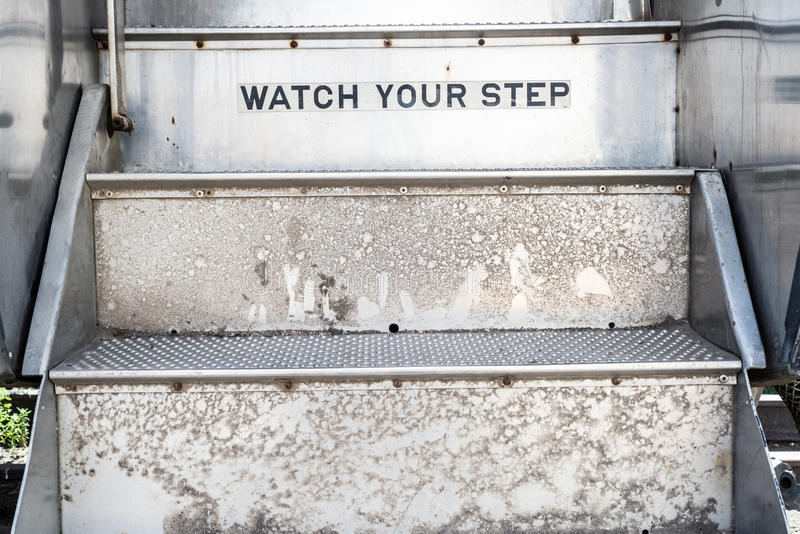 Ogląda twój kroka znaka na schodkach zdjęcia royalty free