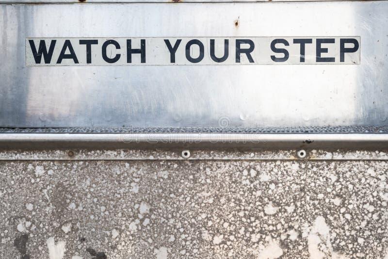 Ogląda twój kroka znaka na schodkach obrazy royalty free