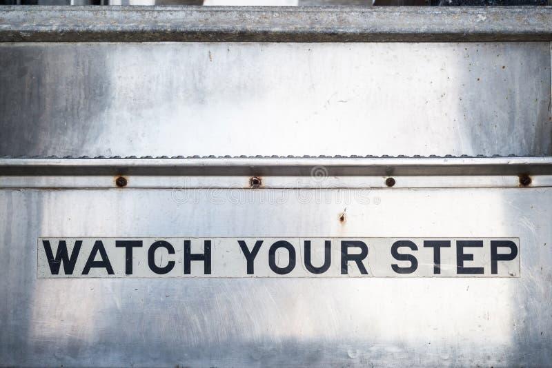 Ogląda twój kroka znaka na schodkach zdjęcie stock